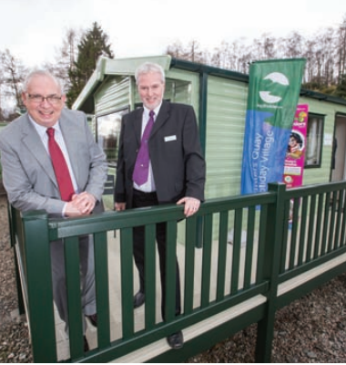 Children in Poverty Inverclyde founder Pat Burke (L) and Argyll Holiday's Hunters Quay Holiday Village general manager David Dain (R) cut the ribbon to the new holiday home.