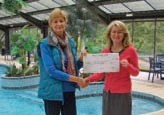 Don Amott director, Samantha Heap (right) hands the cheque for £20,000 to Clerk to the Parish Council, Sheila Pearce.