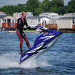 jet ski girl with caravans in back