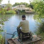 man fishing on the pump house