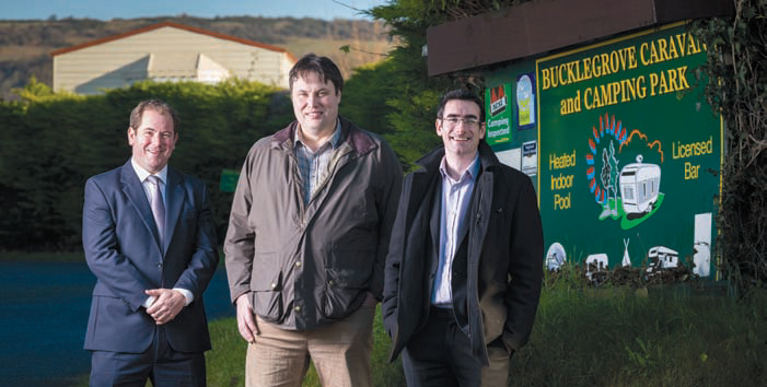 Tourist attraction Wookey Hole has purchased Bucklegrove Holiday Park. Pictured is Wookey Hole Managing Director Daniel Medley (centre) with representatives from legal firm Stephen Scown.