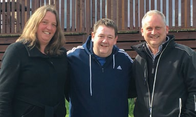 Johnny Vegas takes a break from filming in the company of holiday park owners Barbara and Philip Carr.